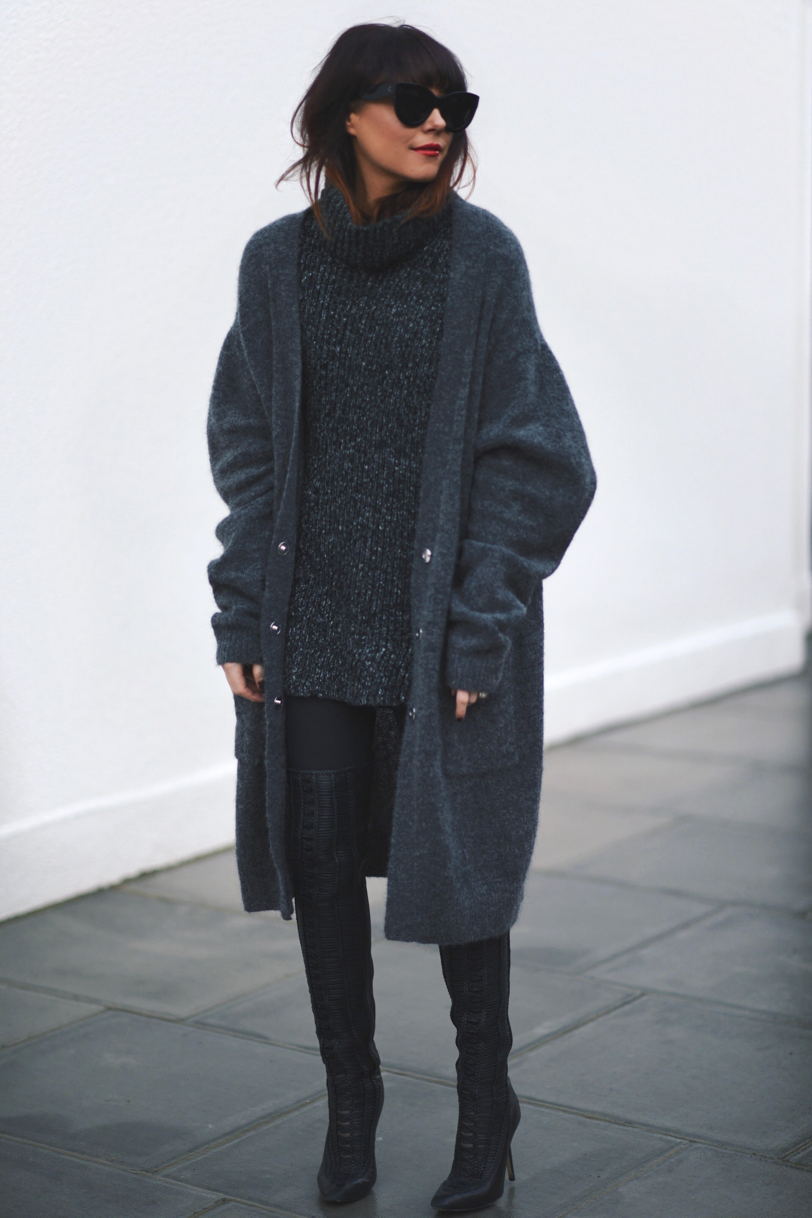 mohair knit cardigan layered over chunky knit turtleneck