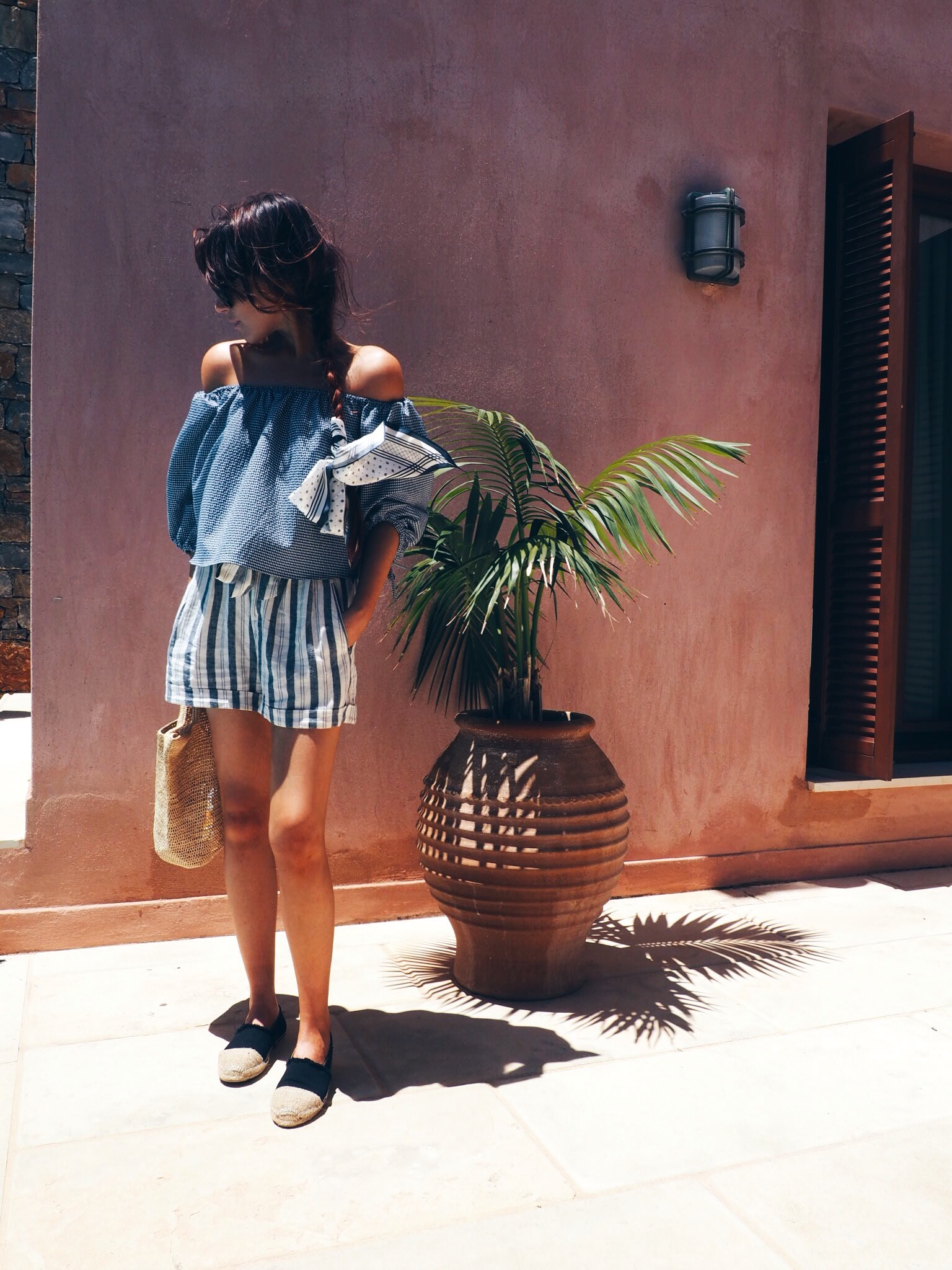 wearing-blue-off-the-shoulder-top-and-shorts-in-crete
